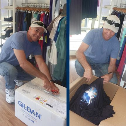 Wayne opens our first ever box, unpacking organic cotton tee's with his own art prints