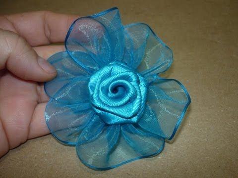 Visita nuestra pagina :http://manualidadeslahormiga.jimdo.com/ https://www.facebook.com/hormigamanualidades?ref=hl Flor grande en cinta organza,  esta flor la pueden elaborar en cinta de  2.5  cms de ancho en adelante, entre mas ancha sea la cinta la flor queda mas grande...recomendamos combinar esta flor con otros modelos de flor para obtener lindos y espectaculares accesorios...    utiliza como guía un pentágono para que te queden del mismo tamaño los pétalos ,. una forma fácil y rápida…