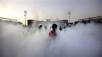 A worker fumigates the field before the start of an Indian Premier League (IPL) cricket match between Delhi Daredevils and Kings XI Punjab in New Delhi