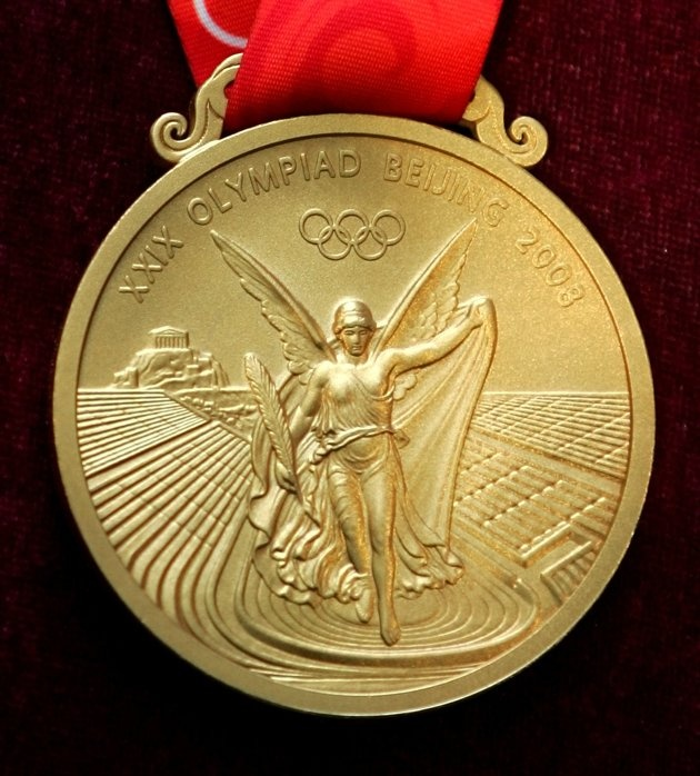 Close-ups of Olympic medals - The gold medal for the 2008 Beijing Olympic Games. (AP Photo/Greg Baker).