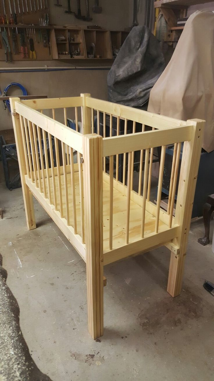 Crib with adjustable height base, which can also be converted to a day bed once baby is big enough for a bed.