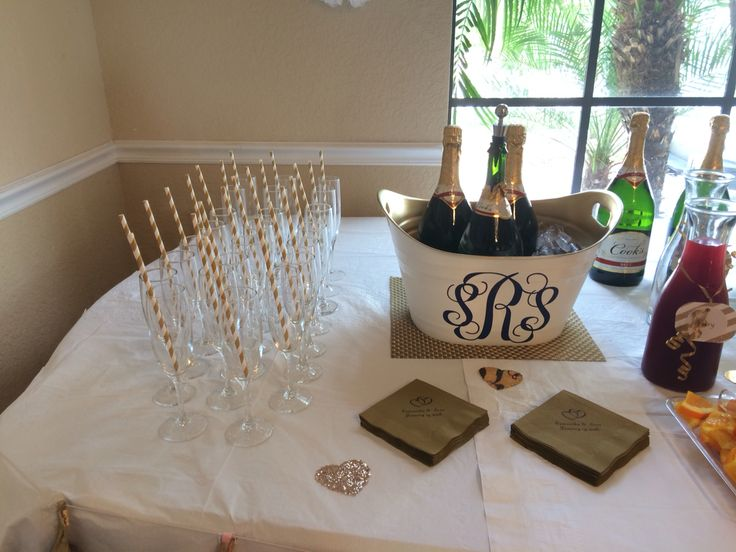 Mimosa Bar with monogrammed ice bucket and Champagne glasses with pretty straws