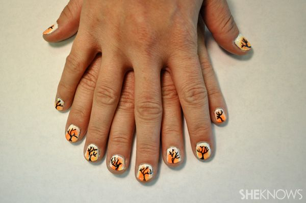 DIY sunset nail design for fall  -  she loved stamping and painting designs on her nails