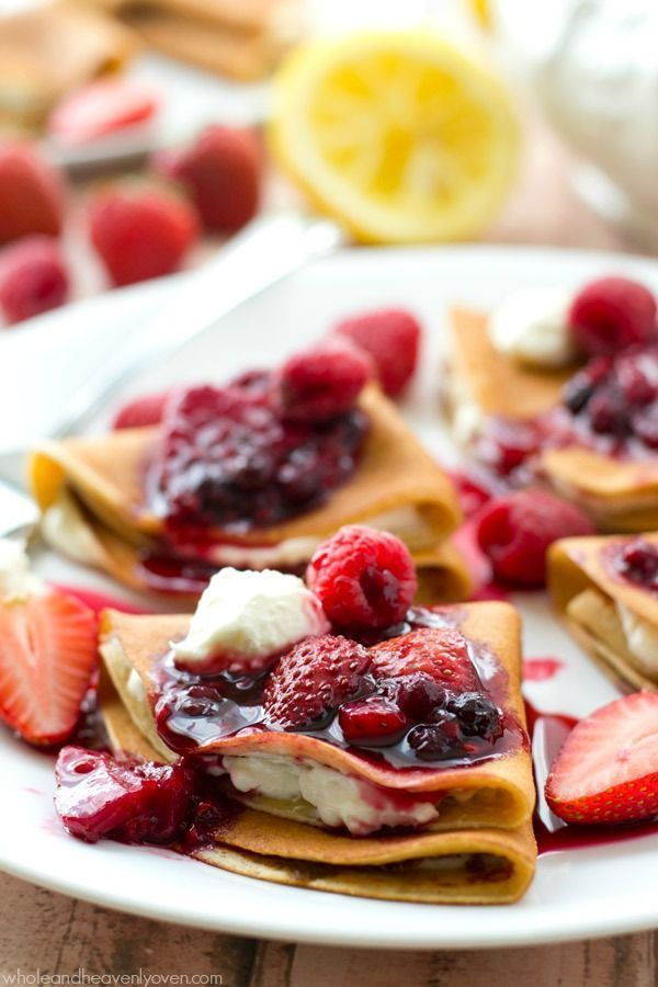 Filled with a tangy lemon cream cheese and topped with an unbelievable triple-berry sauce, these stunning crepes are a dream for any spring brunch! @Whole and Heavenly Oven