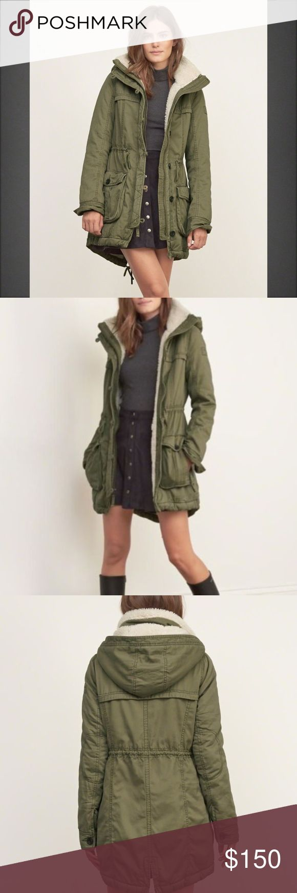 Abercrombie & Fitch Womens Sherpa Lined Jacket Abercrombie and Fitch  Warm and comfortable parka with cozy sherpa lining, a silhouette with a longer length, featuring a removable sherpa lined hood, a button and zipper closure, finished with cinched hem with tie at back, Imported 100% Cotton LARGE NWT Abercrombie & Fitch Jackets & Coats