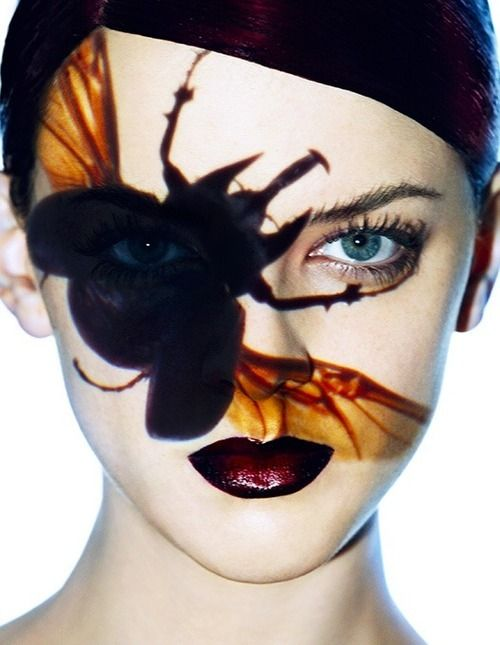 Projected insect onto woman's face.