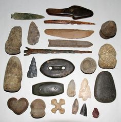 Arrow heads and hunting materials.