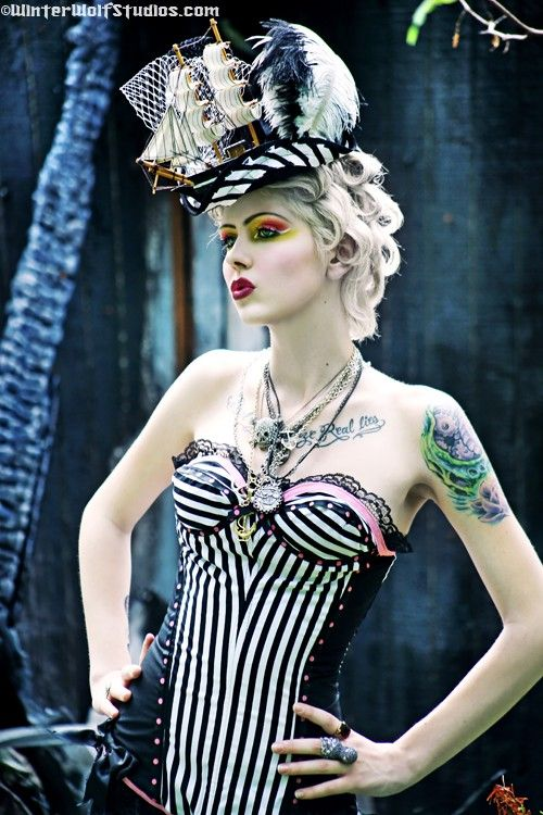 Why can't I have a job that I get to dress up in awesome corsets with freaking cool eye make-up!  And that hat!!