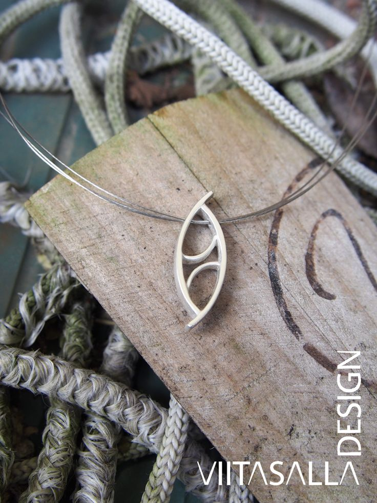 'Turnaround' - A satin-finish silver pendant by Viitasalla Design in a triple jewellery wire necklace. For more visit www.viitasalla.com #metalclay #ArtClaySilver #jewellery #jewelry