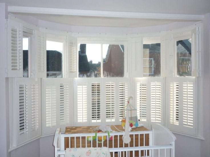 Half shutters? I like it. http://www.stylishshutters.co.uk/wp-content/gallery/bay-window-shutters/white-plantation-shutters-berkhamsted.jpg