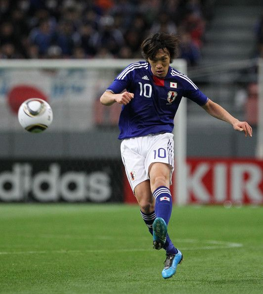 Shunsuke Nakamura Photos - Shunsuke Nakamura of Japan in action during the AFC Asian Cup Qatar 2011 Group A qualifier football match between Japan and Bahrain at Toyota Stadium on March 3, 2010 in Toyota, Japan. - Japan v Bahrain - Asian Cup Qualifier