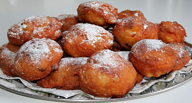 Oliebollen -  Dutch Doughnuts - Oliebollen are a variety of doughnut made by using an ice-scooper or two spoons to scoop a certain amount of dough and dropping the dough into a deep fryer filled with hot oil.  - http://aussietaste.recipes/doughnuts/oliebollen-dutch-doughnuts/  -   #recipe
