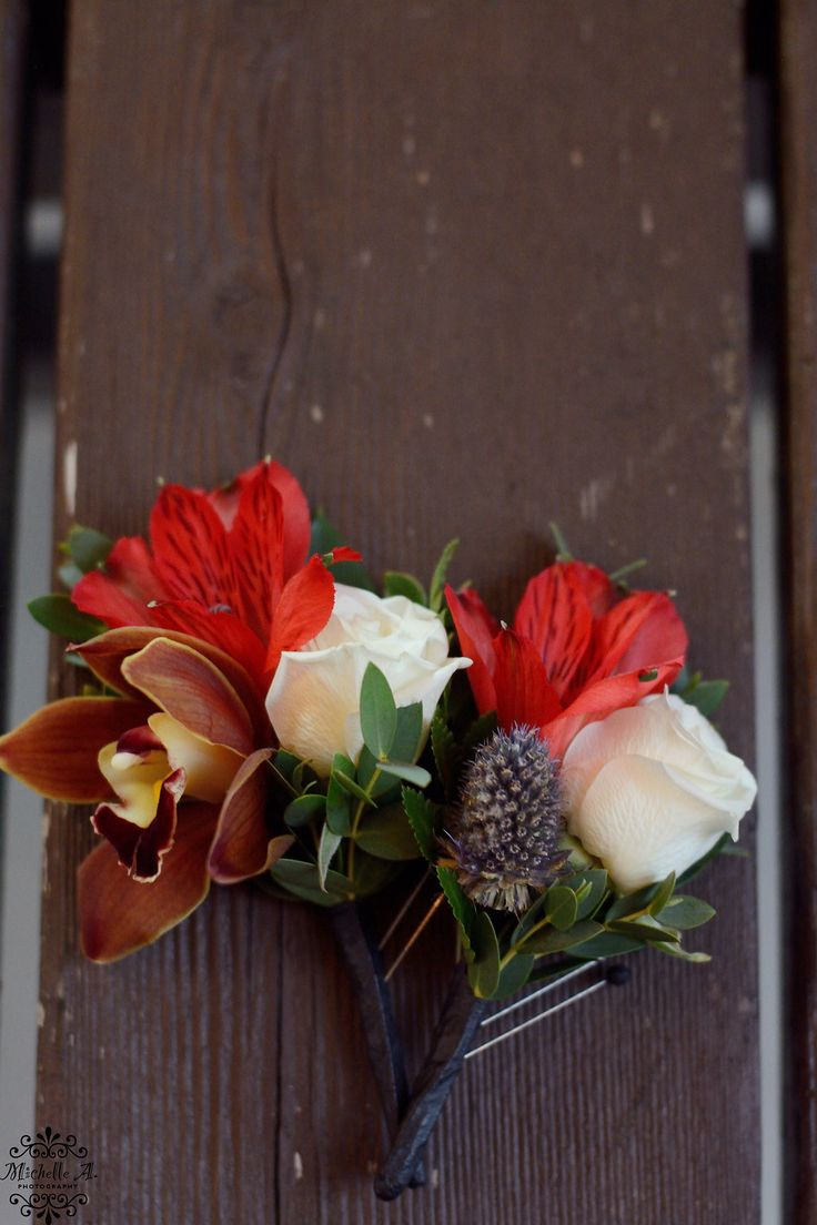 Boutonnieres for a Fall Wedding. Red Alstroemeria blooms, orchid, Sea Holly and Spray Rose. Picture by: @Miche