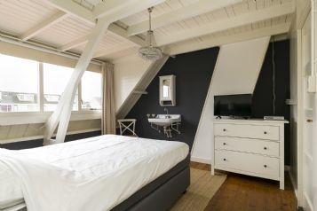 Stijlvolle slaapkamer in een jaren 30 woning.
