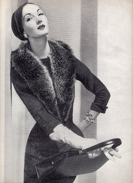 Valentine's Day dress - Something can be said for taking a page from the past, especially when it comes to high fashion. This 1955 Vogue model certainly has a handle on elegance. Imagine showing up for Valentine's Day dinner in something that echoes this fashion statement?