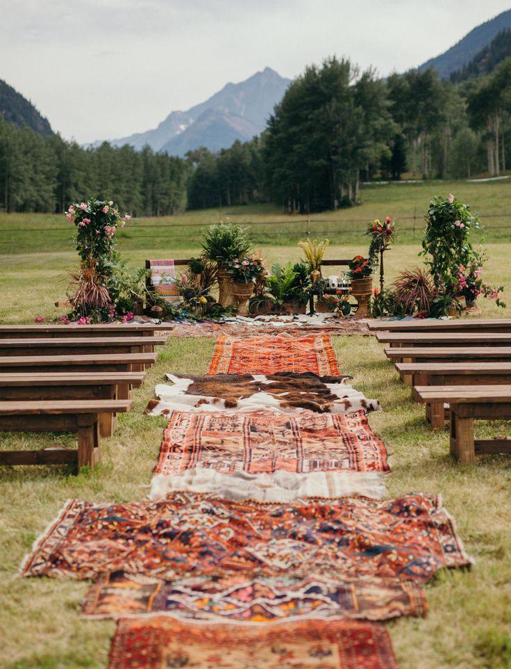 Boho Glam Aspen Wedding with rugs lining the ceremony aisle