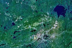 Sudbury crater Credit: NASA  Sudbury crater in Ontario, Canada, clocks in at 81 miles (130 km) wide and 1.85 billion years old, close in age and size to Vredefort crater in South Africa. The original crater is believed to have sprawled 160 miles (260 km). Rock fragments from the impact have been found in Minnesota, over 500 miles (800 km) away.