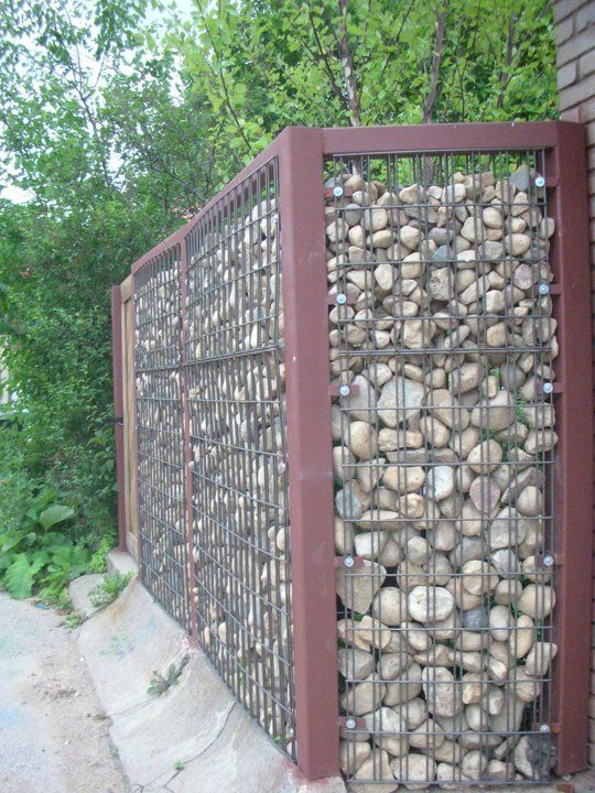 My Great Outdoors: Josh & Heather's DIY Gabion Fence | Apartment TherapyVery much like the idea of a rock fence.
