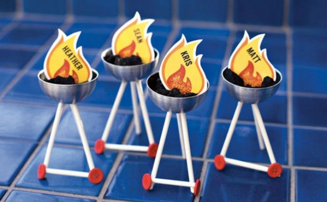DIY Grill Place Cards for Your Next Backyard BBQ! Cut printable paper shapes and add each person's name for a fiery table appeal.