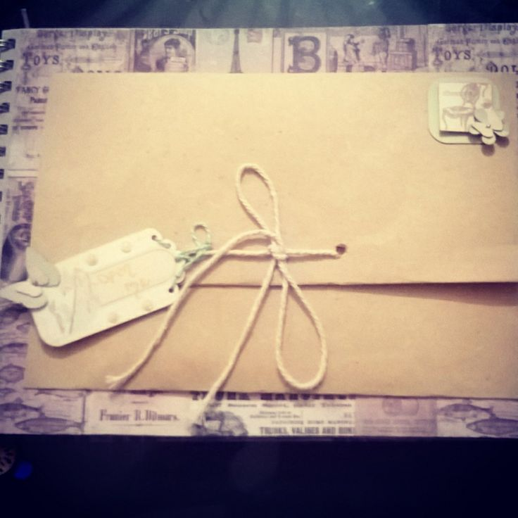 A page inside: perfect for storing keepsakes, memories, photos, secrets ... Alice in wonderland inspired tags attached