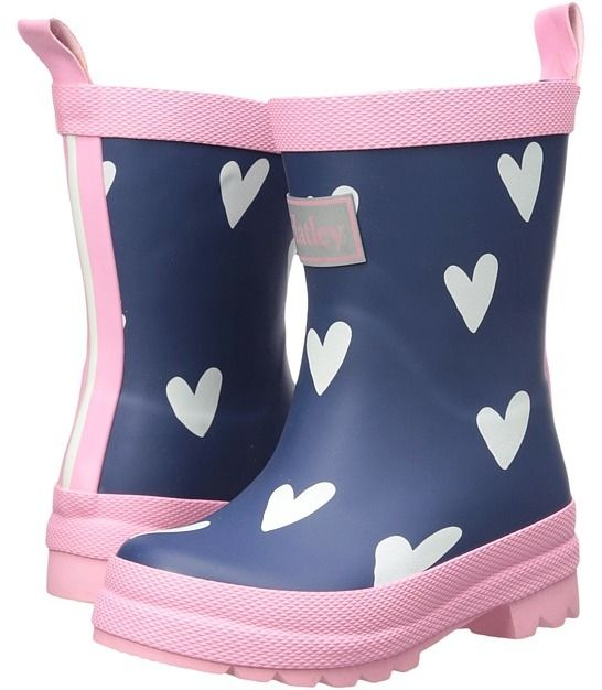 These Hatley Kids Scattered Red Hearts on Navy Rain Boots are a rubber rain boot featuring a scattered heart design.    A rear pull tab on the back of these boots makes it easy for toddlers to pull these boots and and take them off.