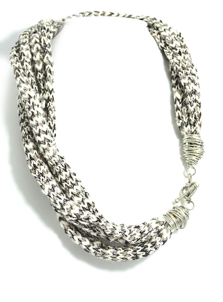 Black and White knitted cords decorated with wire and heart charm.