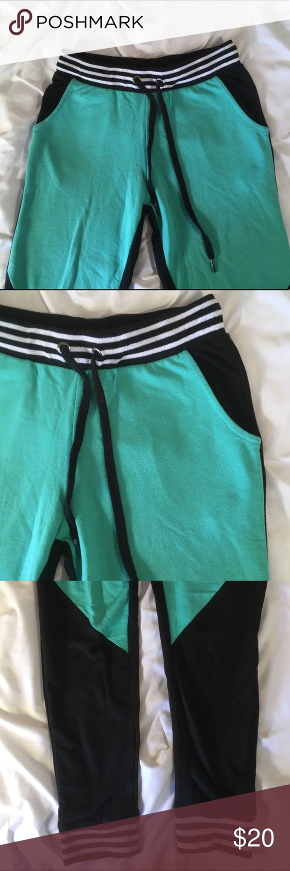 Black and Green Jogger Sweatpants These joggers are so comfy and so stylish. Perfect for relaxing or going to the gym! Used but in good condition. Rue 21 Pants Track Pants & Joggers