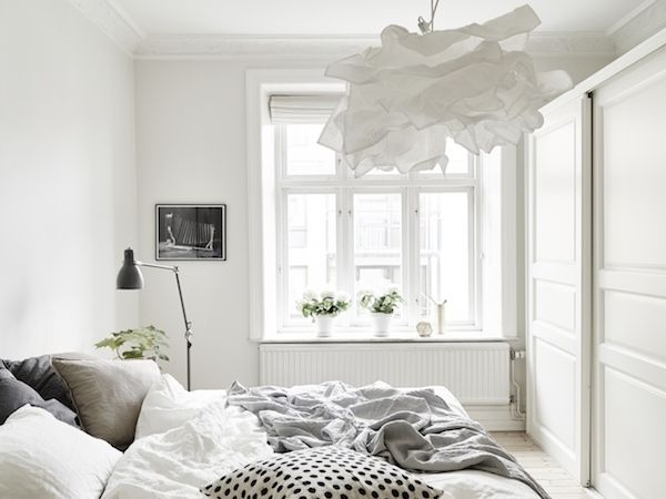 Calm white and grey in a Swedish apartment. Stadshem.