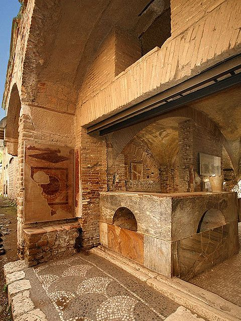 The minimal apartments here were for only sleeping, no kitchens so there was a communal eating area- Thermopolium, (The ancient fast food and bar) Ostia Antica, Italia