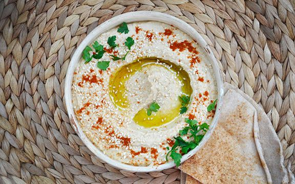 This is the basic Lebanese hummus recipe, made easy and ready in less than 5 minutes! I also added some delicious topping options you can choose from.