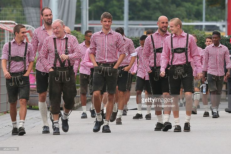 Philipp Lahm (L) team captain of Bayern Muenchen arrives with his team (L-R) Tom Starke, assistent coach Hermann Gerland , Thomas Mueller, Pepe Reina and Sebastian Rode for the FC Bayern Muenchen Paulaner photo shoot in traditional Bavarian lederhosen at Bayern Muenchen's headquarter Saebener Strasse on August 31, 2014 in Munich, Germany.