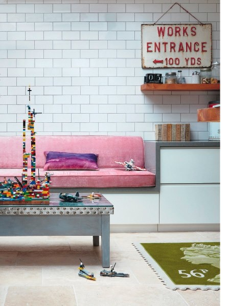 Love this kitchen featured in LivingEtc! Timeless subway tiles, industrial sign, and pink velvet bench seat