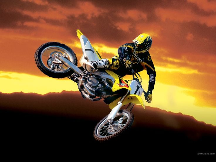Dirtbike jump with a beautiful sunset.