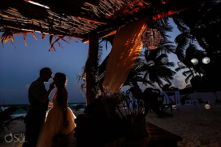 Couple gets married in Akiin Beach Club wedding at Tulum in the amazing Riviera Maya with the perfect dusk light. Photo by Sol.