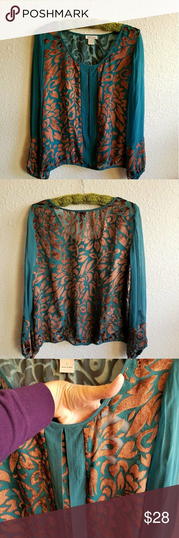 """Lucky Sheer Teal Green & Brown Blouse Gorgeous peacock green & raised brown velvety vines make this sheer blouse a go to for your fall and winter wear. Such a warm and rich feel to this piece. Try it with a long beige skirt and tall boots. Wear it with flare jeans, wedges, and a trench coat. Many, many possibilities! Bust: 20.5"""", Length: 23"""", Shoulder: 16"""", Bottom: 18"""" unstretched elastic band, Arm: 23.5"""" from the top of the shoulder, arm opening: 4.25"""" unstretched. Lucky Brand Tops Blouses"""