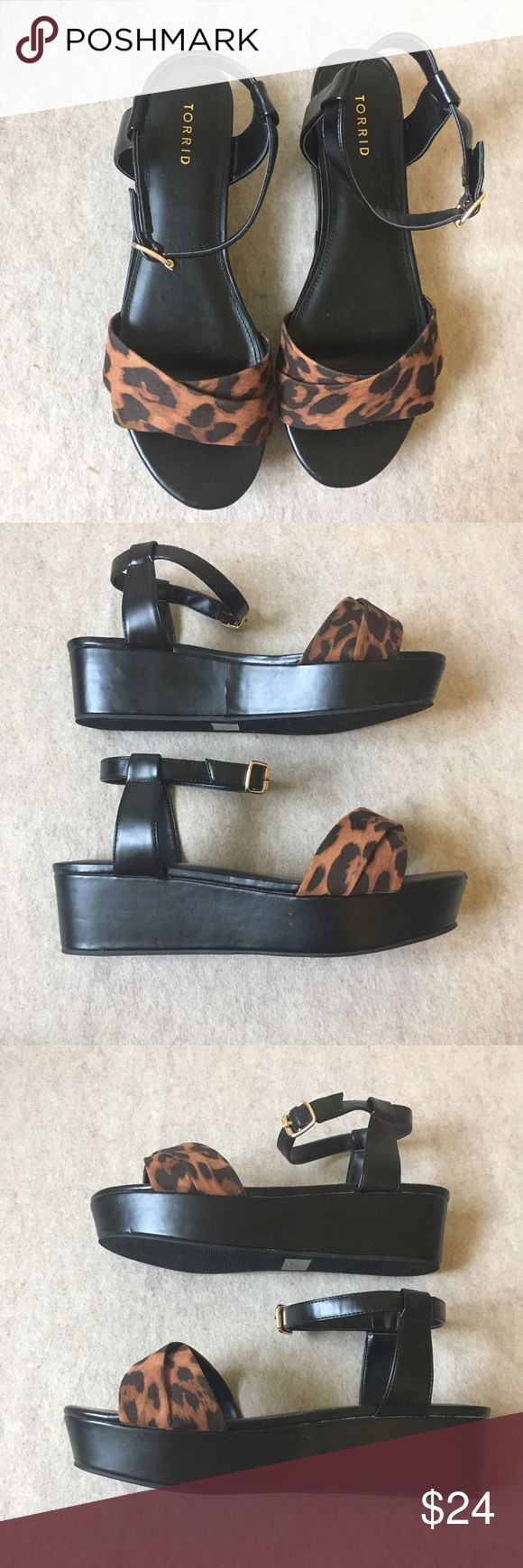 Torrid Black Platform Wedge Sandals Leopard 11W Torrid Black Platform Wedge Sandals With Leopard Print Straps Women's Size 11 Wide  Gently used, normal signs of wear. Please see all photos torrid Shoes Platforms