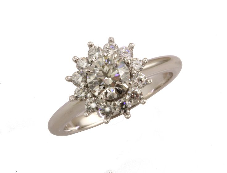 Round brilliant diamond with diamond halo in 18ct white gold engagement ring