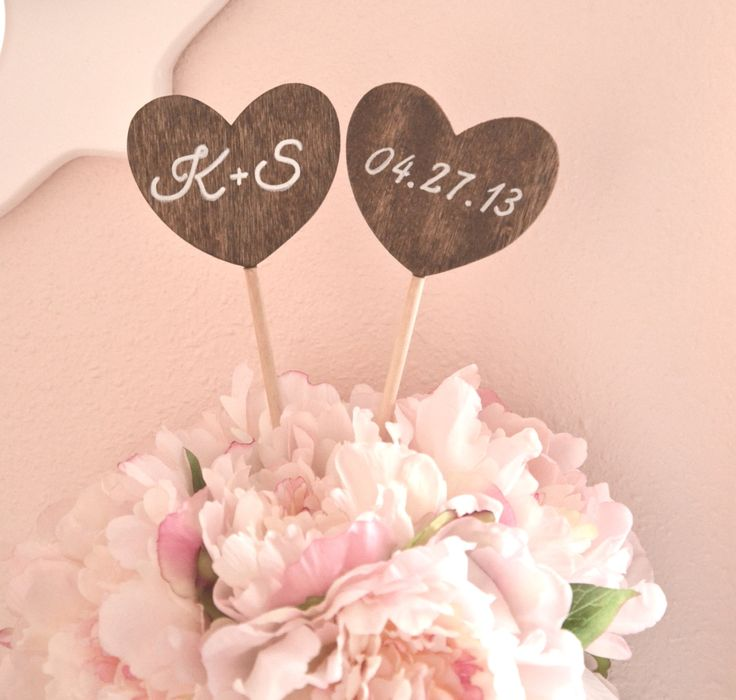 Personalized heart shaped wedding cake topper with initials and date. $21.00, via Etsy.