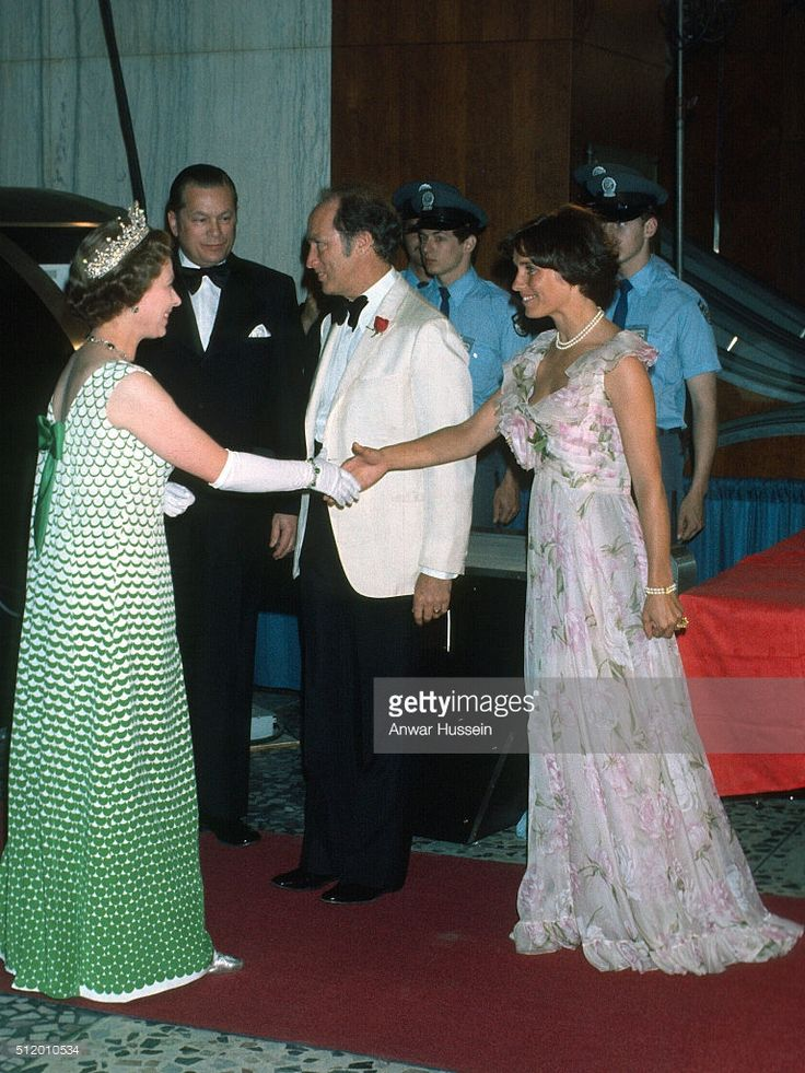 Queen Elizabeth ll shakes hands with Margaret Trudeau as she arrives at a formal event on August 01, 1976 in Canada.