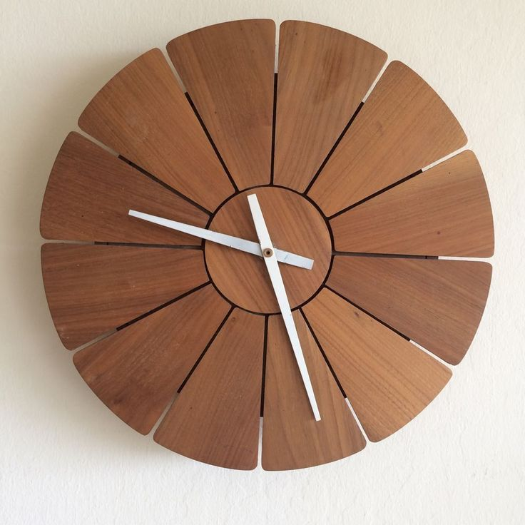 """Vintage walnut petal wall clock with a German Kienzle quartz movement that keeps accurate time, in great vintage condition with no damage. 14"""" diameter and 2.25"""" deep."""