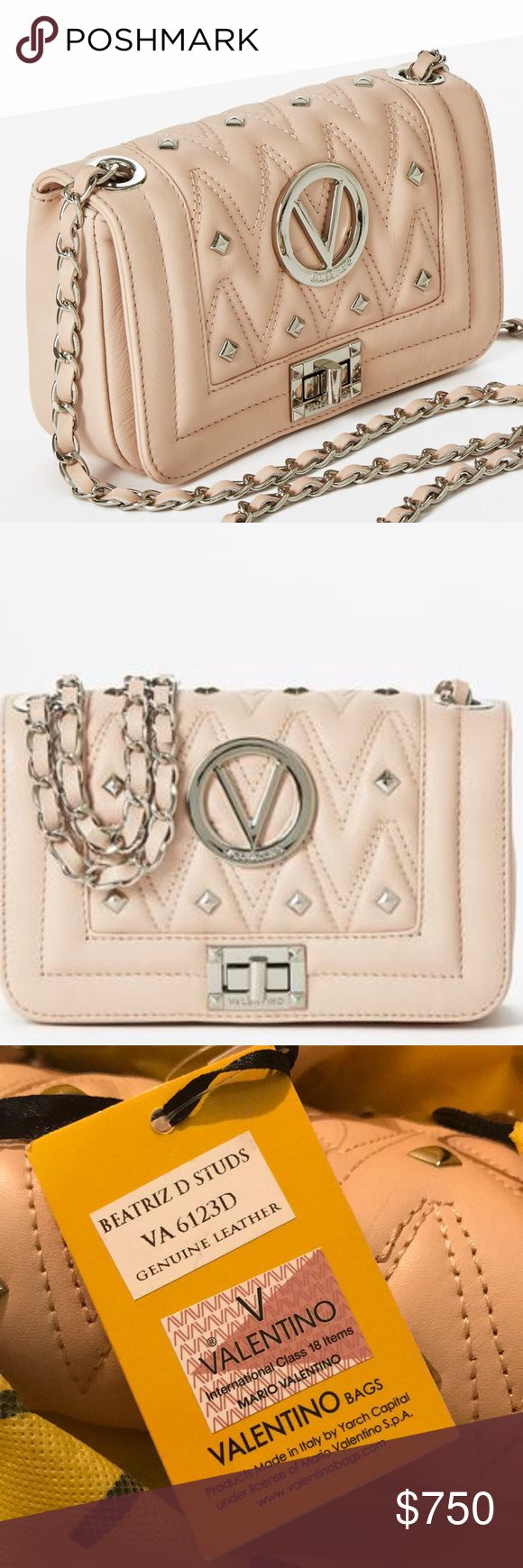 "🌹NWT🌹VALENTINO WEEKEND SALE ONLY ❌ NO OFFERS‼️ 💠NWT💠VALENTINO New Diamond BEATRIZ D Rose🌹Doree. Color: Pink/Silver Hardware. Condition: In NWT Condition, with no visible flaws yay❣️ Features a leather-woven chain shoulder strap.  Center zip compartment One zip pocket, one card pocket 9""W X 5""H X 3""D, 22"" strap drop. Comes with original Dust Bag & Care Card. ❌E-Mails ❌Trades ❌Lowball Offers Please‼️ Feel free to ask me any questions, that I may have missed in description. 😊 VALENTINO…"