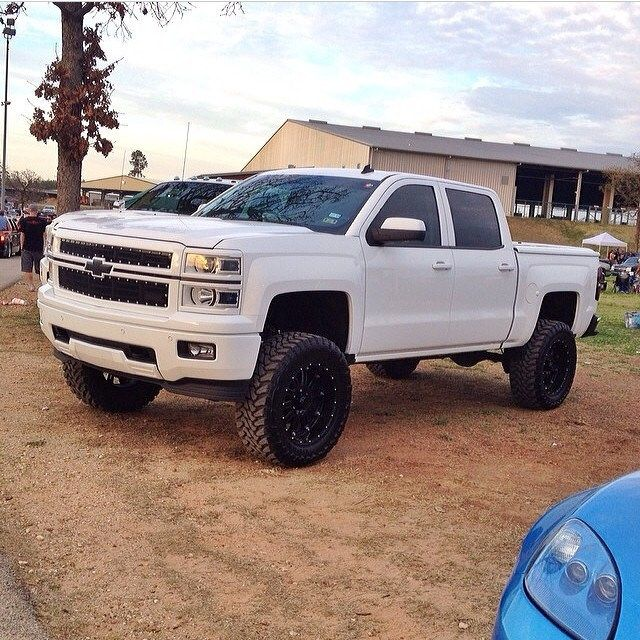 White lifted Chevrolet Silverado truck with Chevy Bow-Tie. Yes, please!
