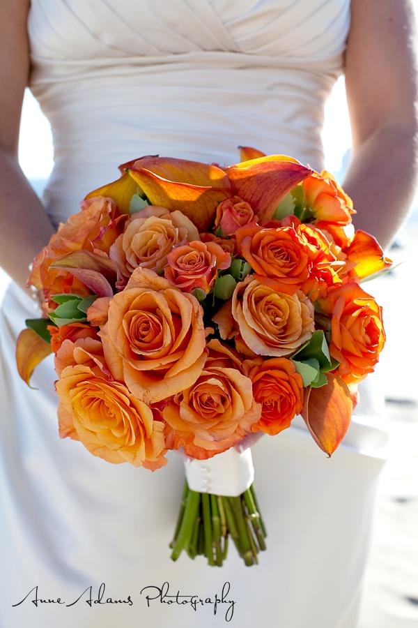 Orange mix flower bouquet.  Flowers of Charlotte loves this!  Find us at www.charlotteweddingflorist.com