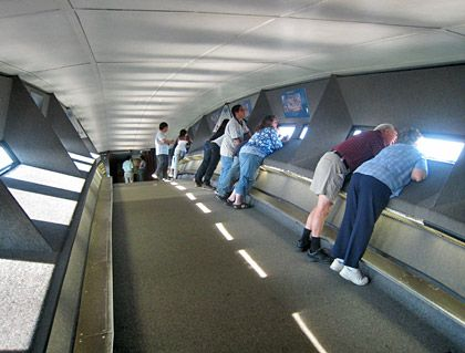 Visitors peer out of these narrow windows of the Gateway Arch in Saint Louis, Missouri.