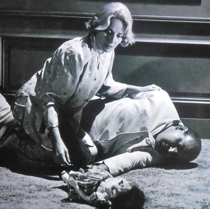 """Living Doll"" Mary La Roche looks at Telly Savalas laying on the floor, near the end of this unforgettable episode. My name is Talky Tina, and I'm beginning not to like you!"