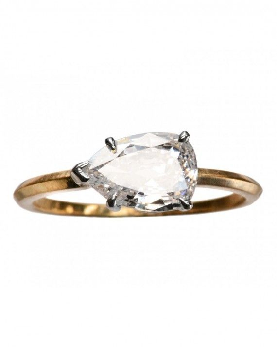 Looking for something a bit ... quirkier? Put a spin on the classic engagement ring setting—literally! East-West engagement rings feature diamonds that are placed horizontally on the band, in comparison to a traditional setting, a vertically placed stone.Erie Basin Pear Diamond Ring, price upon request, eriebasin.com.