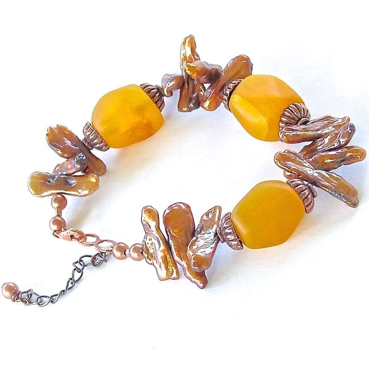"Elektor: Amber Colored Handmade Beaded Bracelet  This golden yellow sea glass and freshwater pearl bracelet will carry the feeling of summer sun into the seasons to come. Closes at 7"" with a 1"" extender."