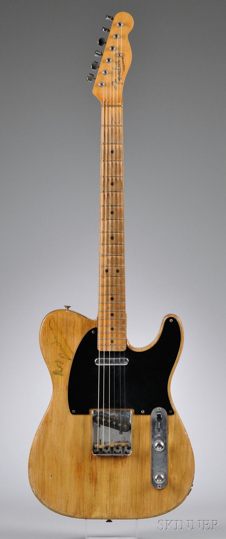 Lot 44   American Electric Guitar, Fender Electric Instruments, Fullerton, 1952/67, Model Telecaster, stamped 0686 on the bridge plate, the later neck, stamped 93089 on the neck plate, signed on the body, length of back 15 3/4 in., with later case and article of ownership.     Provenance: Roy Buchanan, Mark Rowley, Rock Star Rentals.   Estimate $75,000-100,000