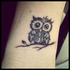 Cute little owl tattoo.   best stuff