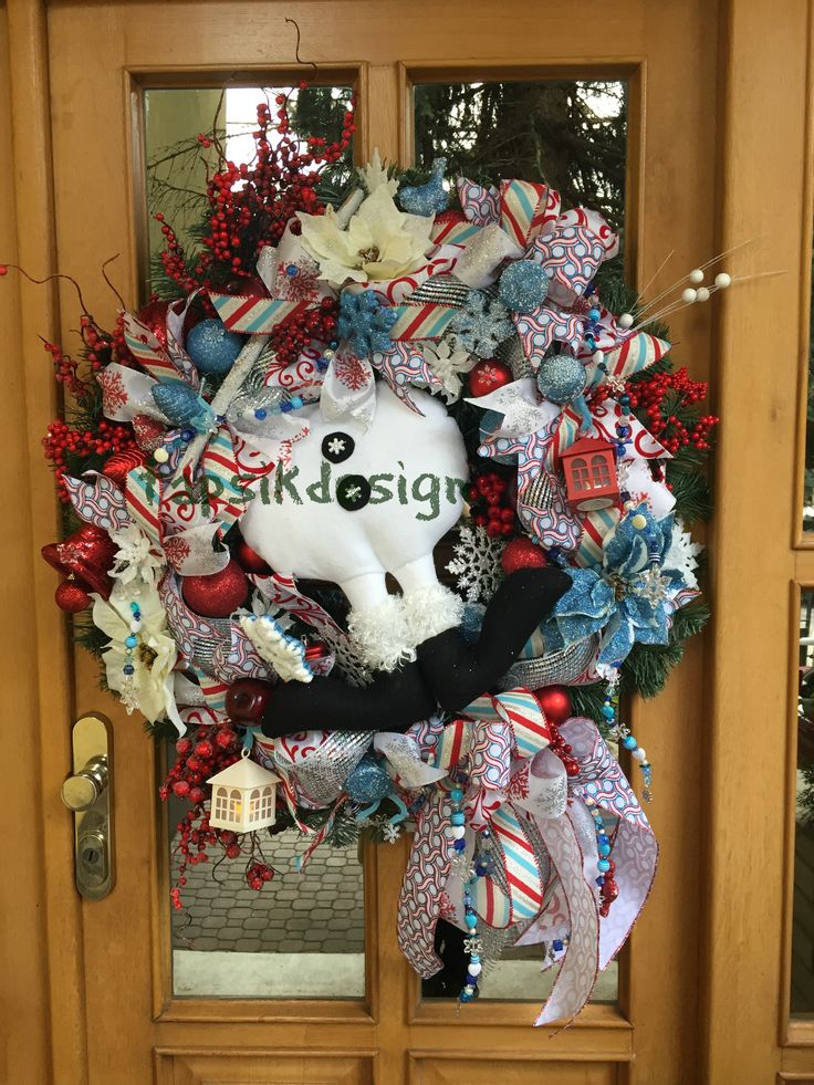 Christmas snowman. Really XXXL wreath. Base artificial greenery wreath, full of ribbon strips, funky bow, christmas decorations, artificial branches, lanterns, poinsettias, birds and in there one snowman legs.